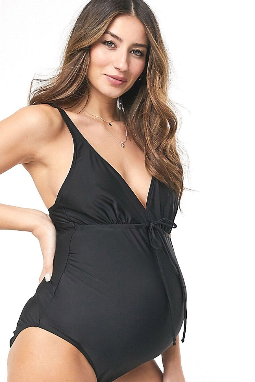 Svart mama baddräkt gravid